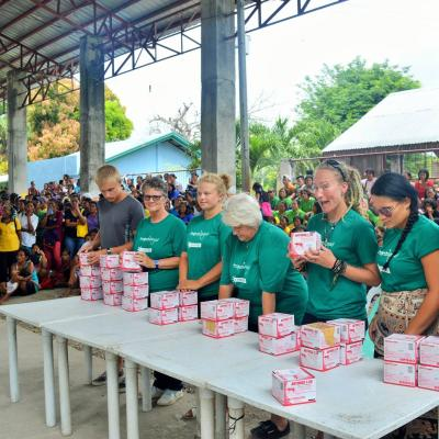 Medical volunteers hand out larvicide to prevent mosquitoes from breeding in the Philippines.
